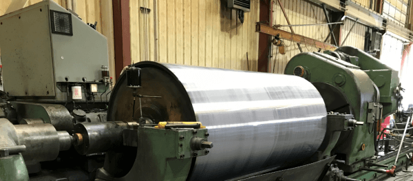 Large Mill Roll in Grinder